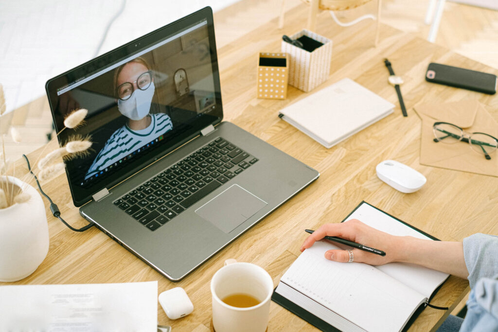 Woman Having Video Call in Home Office