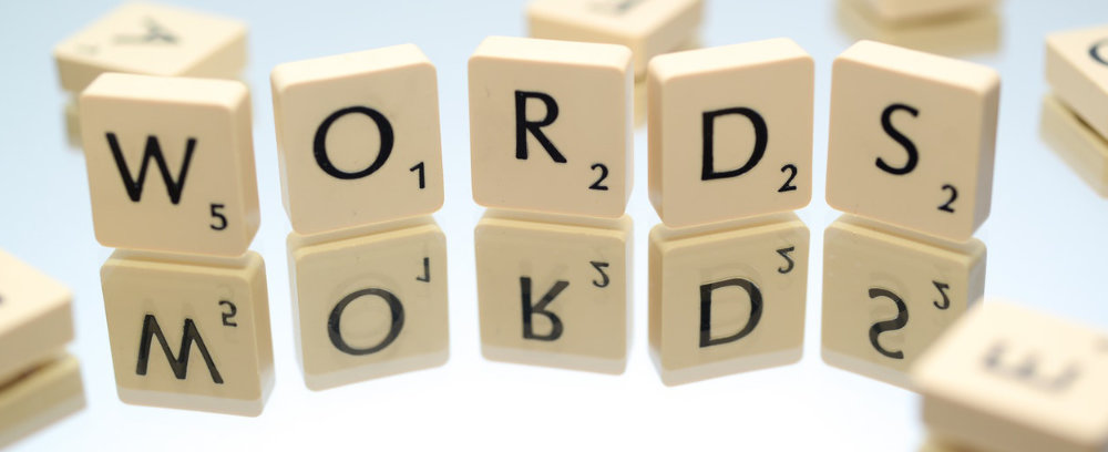 """Scrabble pieces that spell """"words"""""""